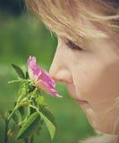 Child smelling blossom Stock Photos
