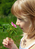 Child smelling blossom Stock Images