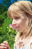Child smelling blossom Stock Photography