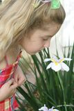 Child smelling flower Stock Photo