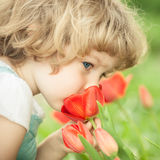 Child smelling tulip Royalty Free Stock Photos