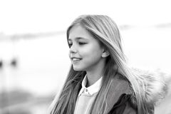Child smile on blurred environment. black and white. Child smile on blurred environment. Girl with blond long hair on autumn day outdoor. Happy childhood concept stock photography