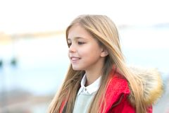 Child smile on blurred environment. Girl with blond long hair on autumn day outdoor. Happy childhood concept. Kid fashion and style. Beauty, look, hairstyle royalty free stock photos