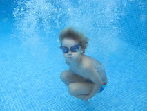 The child smile underwater Stock Photo