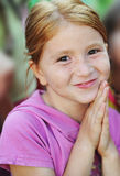 Child smiles. Fine smile of the little and charming girl Stock Photography