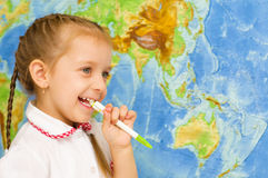 Child smiles by world map Royalty Free Stock Image