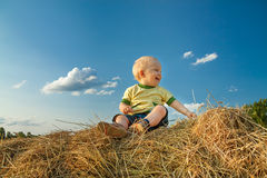 Child smiling against the blue sky. The little child smiling against the blue sky Stock Images