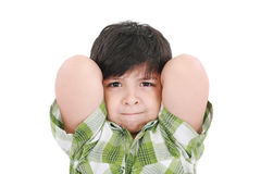Child smiling with arms up behind his head Stock Image