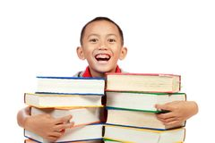 Child smiling with book on his chest Stock Photo