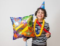 Child smiling during his birthday and over gray background. Stock Photography