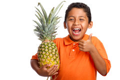 Child Smiling and Holding Pineapple with Thumb Up royalty free stock photography