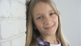 Child Smiling Looking at Camera, Kid Laughing, Happy Expression School Girl Face.  stock photography
