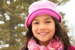 Child smiling outdoors in winter Stock Photography