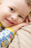 Child smiling positive. Baby boy child smiling positive over light background Royalty Free Stock Photography