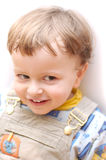 Child smiling positive. Baby boy child smiling positive over light background Royalty Free Stock Image