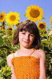 Child smiling in a sunflower field Stock Image