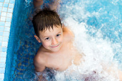 Child smiling in the swimming pool Royalty Free Stock Photos