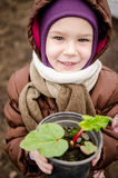 Child smilling with rhubarb Stock Images