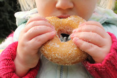 Child snacking on unhealthy chocolate donut Royalty Free Stock Image