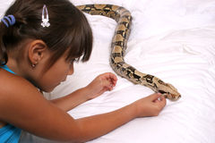Child and Snake Royalty Free Stock Images