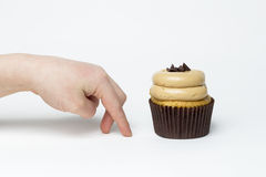 Child Sneaking Gluten Free Cupcake Royalty Free Stock Photography