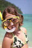 Child snorkeler on the beach. Girl with mask and snorkel diving Stock Image