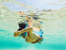 Child snorkeling in clear water Stock Photos