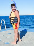 Child snorkeling at red sea stock photos