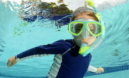Child snorkeling and swimming in pool Royalty Free Stock Photography