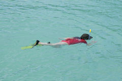 Child snorkelling in the blue laggon Royalty Free Stock Photo