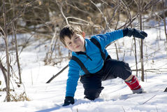 Child on the snow Stock Images