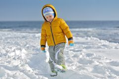 The child on snow Stock Photos