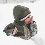 Child in snow Stock Photo