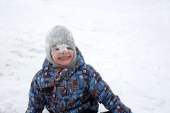 Child with snow on face Stock Images