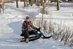 Child on a snow racer Royalty Free Stock Photos
