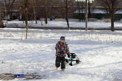 Child with a snow racer Stock Image