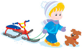 Child with a snow scooter and pup Stock Photos
