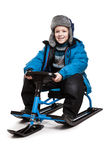 Child on snow scooter or snowmobile toy Royalty Free Stock Image