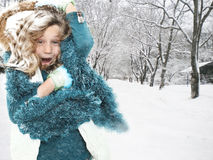 Child in Snow Storm Blizzard. Freezing cold seven year old girl in snow storm outside royalty free stock images
