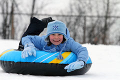Child on snow tube Royalty Free Stock Image