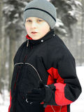 Child in the snow in warm clothes Stock Photo