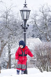 Child in snow winter park Royalty Free Stock Photos