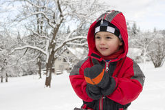Child in snow in winter Royalty Free Stock Image