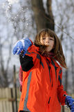 Child in snowball fighting Stock Photo