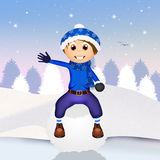 Child on snowball Stock Image