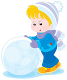 Child with a snowball. Little boy or girl made a big snowball to make a snowman Stock Images
