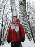 Child in snowbound forest Royalty Free Stock Image