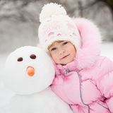 Child with snowman Stock Images