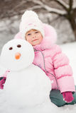 Child with snowman Royalty Free Stock Photography