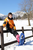 Child with snowshoes in the mountains Stock Photo